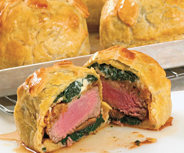 Individual beef Wellington with buttered spinach